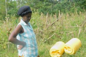 The Water Project: Eshiakhulo Community, Asman Sumba Spring -  Rose Anzwenu