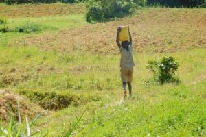 The Water Project: Sichinji Community, Kubai Spring -  Carrying Water