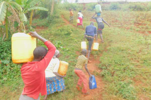 The Water Project: Busichula Community, Marko Spring -  Carrying Water Up The Slope