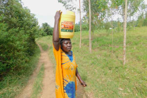 The Water Project: Eshiakhulo Community, Asman Sumba Spring -  Carrying Water