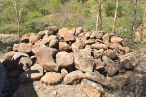 The Water Project: Kithumba Community B -  Stones Collected By Community