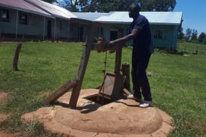 The Water Project: Musasa Secondary School -  School Cook Getting Water