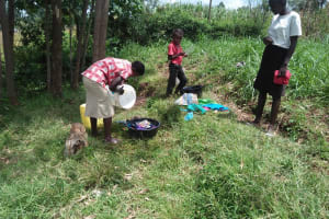 The Water Project: Shihungu Community, Shihungu Spring -  Washing Clothes By The Spring
