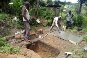 The Water Project: Ivinzo Commuity, Mushianda Spring -  Sanitation Platform Construction