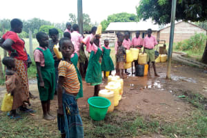 The Water Project: Mukhweya Primary School -  Fetching Water From The Secondary School