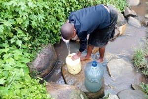 The Water Project: Imbinga Community, Arunga Spring -  Fetching Water