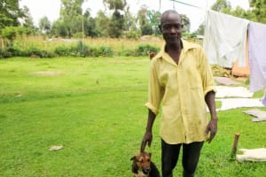 The Water Project: Shisere Community, Richard Okanga Spring -  A Man And His Dog