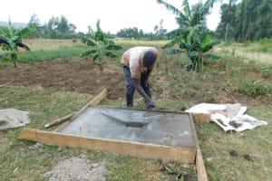 The Water Project: Lunyi Community, Fedha Mukhwana Spring -  Latrine Platform Construction