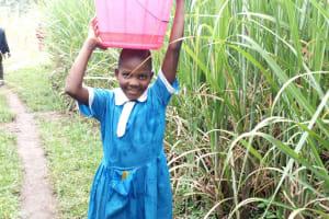 The Water Project: Burachu B Community, Namukhuvichi Spring -  Janet Ambone Carrying Water