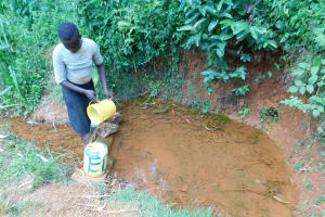 The Water Project: Mukhunya Community, Mwore Spring -  Fetching Water