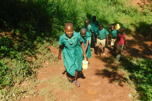 The Water Project: Friends School Mutaho Primary -  Carrying Water To School