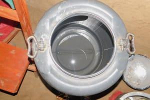 The Water Project: Ataku Community, Ngache Spring -  Water Storage
