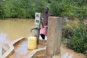 The Water Project: Mwau Community -  Fetching Water