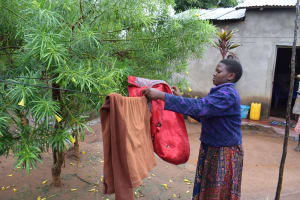 The Water Project: Mwau Community -  Hanging Clothes On The Line