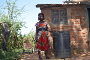 The Water Project: Kathuli Community -  Standing With Water Container