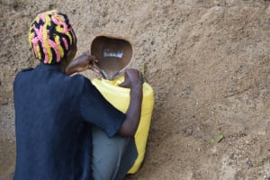 The Water Project:  Filling Water Container