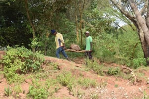 The Water Project: Kala Community B -  Carrying Rocks For Project