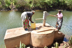 The Water Project: Kala Community B -  Collecting Water From Well