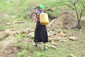 The Water Project: Mbiuni Community -  Carrying The Full Container