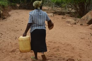 The Water Project: Katovya Community -  Carrying Water Home