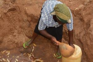 The Water Project: Katovya Community -  Fetching Water
