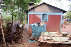 The Water Project: Mwau Community A -  Dishrack And Stored Firewood