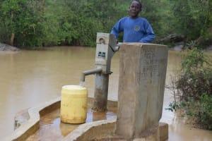 The Water Project: Mwau Community A -  Fetching Water