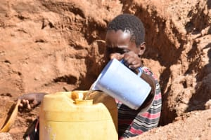 The Water Project: Tulimani Community A -  Filling Container