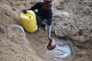The Water Project: Kathungutu Community A -  Scooping Water