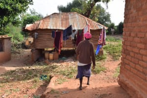 The Water Project: Utuneni Community C -  Walking In Compound