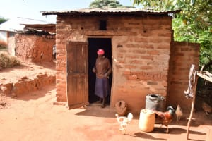 The Water Project: Utuneni Community C -  Wallking Out Of The Kitchen
