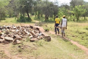 The Water Project: Kala Community C -  Hauling Rocks For Project