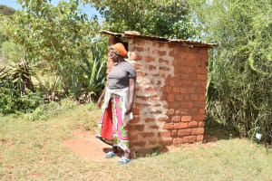 The Water Project: Kala Community C -  Standing Outside Of Latrine