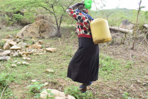 The Water Project: Mbiuni Community A -  Returning With Water