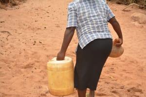 The Water Project: Katovya Community A -  Hauling Ewater