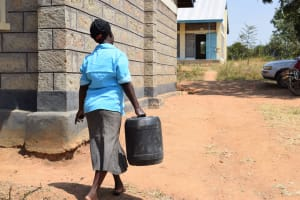 The Water Project: Kyamatula Secondary School -  Carrying Water