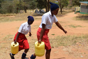 The Water Project: AIC Kyome Girls' Secondary School -  Students Carrying Water