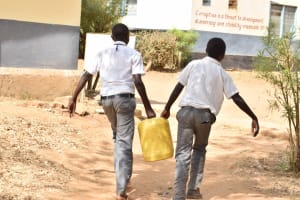 The Water Project: AIC Kyome Boys' Secondary School -  Carrying Water Back To School