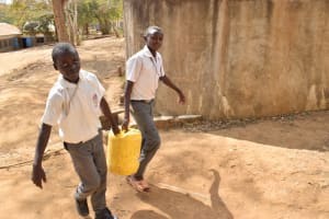 The Water Project: AIC Kyome Boys' Secondary School -  Students Carrying Water