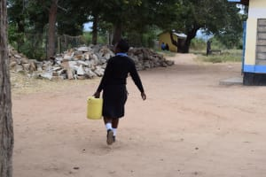 The Water Project: Kiundwani Secondary School -  Carrying Water