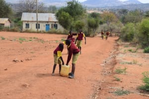 The Water Project: Nguluma Primary School -  Picking Up Container With Water