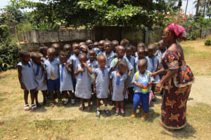 The Water Project: Mummy Ann's Pre-Primary School -  Students And Mrs Nsenesie