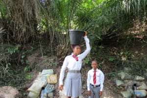 The Water Project: Rowana Junior Secondary School -  Carrying Water