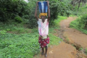 The Water Project: 45 Main Motor Road, The Redeemed Christian Church of God -  Carrying Water