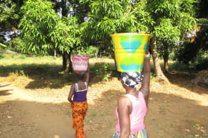 The Water Project: UBA Senior Secondary School -  Carrying Water Home