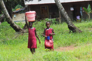 The Water Project: DEC Makassa Primary School -  Carrying Water