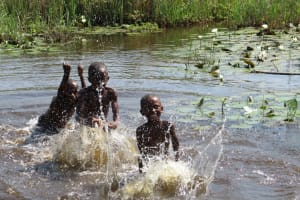 The Water Project: Lungi, Tonkoya Village -  Children Take A Bath In Swamp