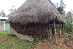 The Water Project: Eshikhugula Community, Shaban Opuka Spring -  Bricks
