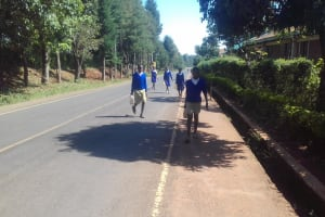 The Water Project: Kima Primary School -  Students Returning From Lunch With Water