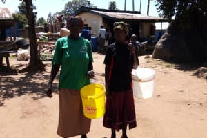 The Water Project: Banja Secondary School -  Parents Carrying Water To School In Place Of Fees